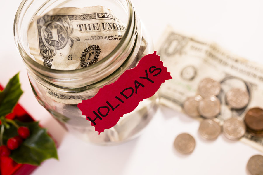 Money in a jar for the holiday season, having a holiday budget
