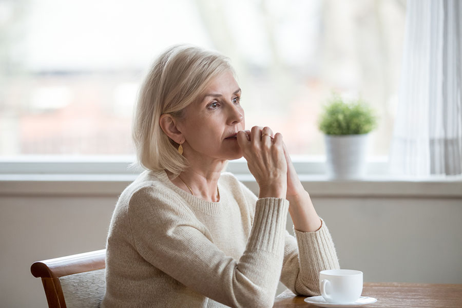 Sad older woman who can't afford retirement