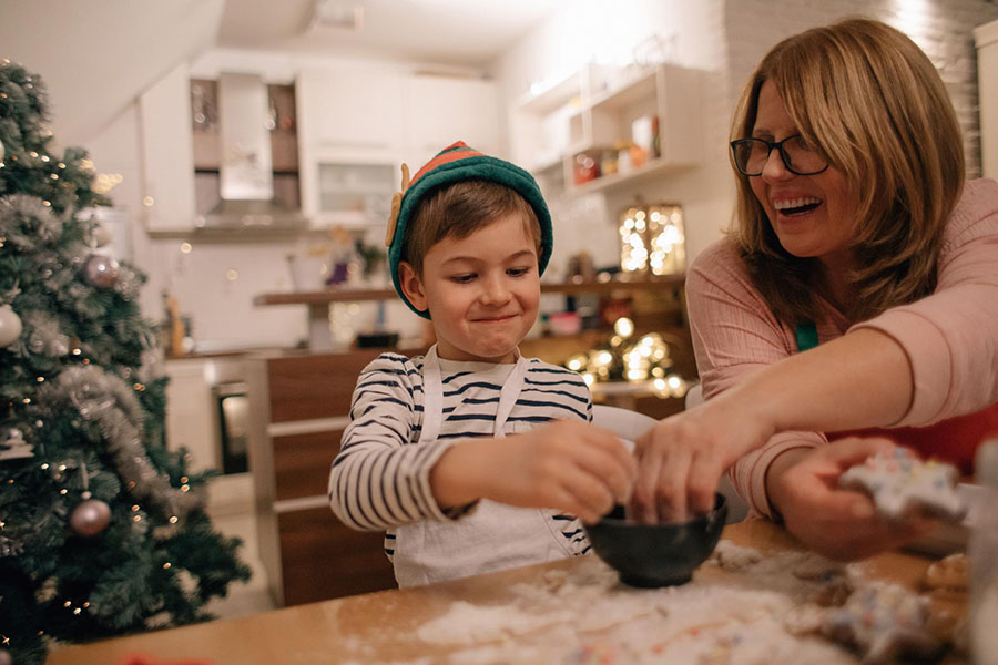 A mother baking cookies with her son for the holidays, can't afford gifts